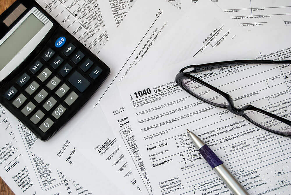 financial papers and a calculator